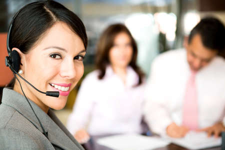 Friendly woman working as a telemarketing agent  photo