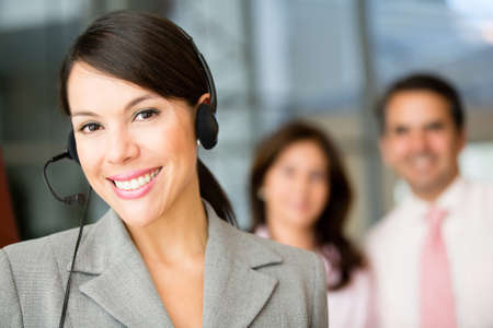 Woman wearing a headset working at customer support  photo