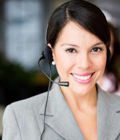 Friendly receptionist smiling and wearing a headset  photo