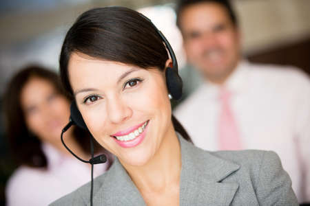 customer assistant: Woman working at a call center and wearing headset