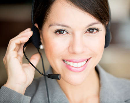 Female customer support operator with a headset  photo