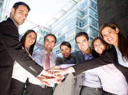 workers group: Business team with hands together - teamwork concepts