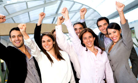 success business: Business group with arms up celebrating their success