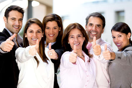 people in office: Successful business people with thumbs up and smiling  Stock Photo