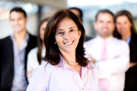 Successful businesswoman leading a group and smiling  photo