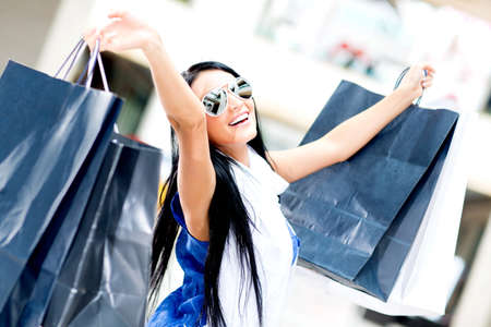 excited woman: Excited woman shopping for the summer and smiling  Stock Photo