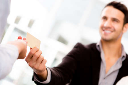Business man paying with a credit or debit card  photo