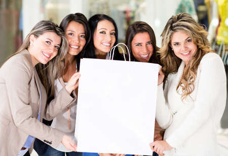 Group of women holding a shopping bag  photo