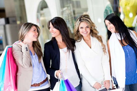 friends shopping: Group of women walking at the shopping center