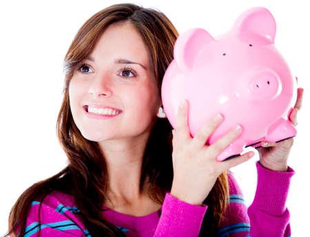 coinbank: Mujer la celebraci�n de una alcanc�a y sonriendo - aislados en blanco