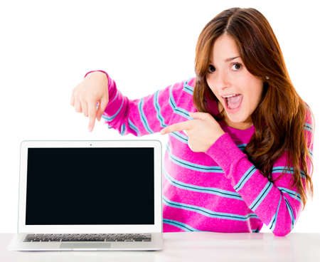 excited woman: Excited woman with a computer pointing the screen - isolated over white