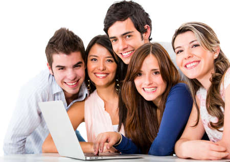 computer education: Group of friends with a laptop computer - isolated over white