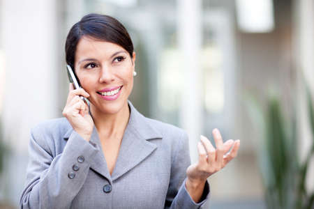 Successful businesswoman talking on her mobile phone  photo