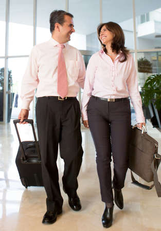 travelers: Couple on a business trip at the hotel