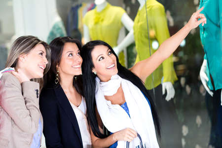 Group of women window shopping at the mall  photo