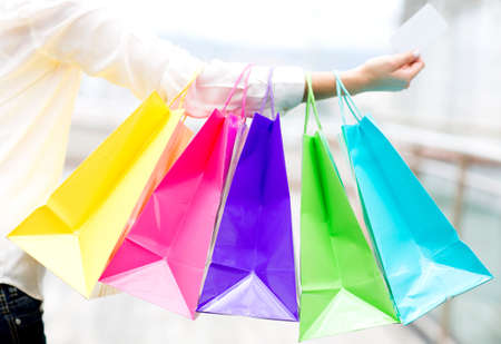 Woman shopping with a credit or debit card Stock Photo - 13967097