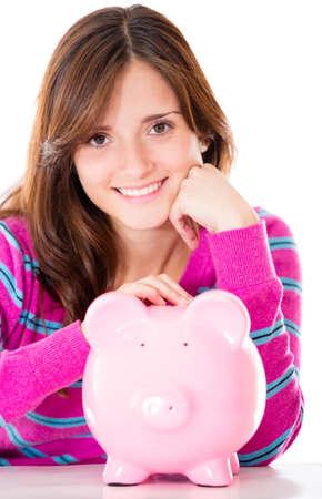 coinbank: Mujer ahorrar dinero en una hucha - aislados en un fondo blanco Foto de archivo
