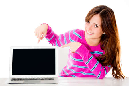 Woman pointing a computer screen - isolated over white background  Stock Photo - 13967124