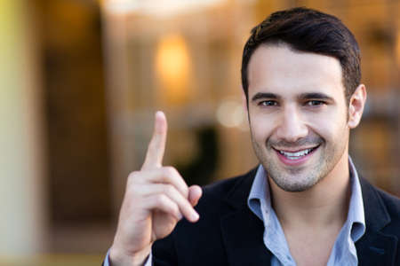 Successful businessman pointing an idea and smiling  Stock Photo - 13977960