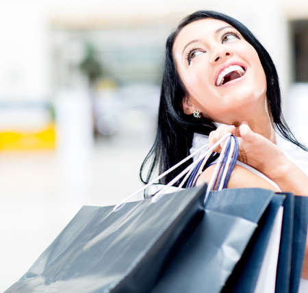 shoppingbag: Happy female shopper at the shopping center  Stock Photo