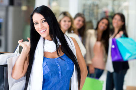 Happy woman out shopping with her friends  Stock Photo - 13977956