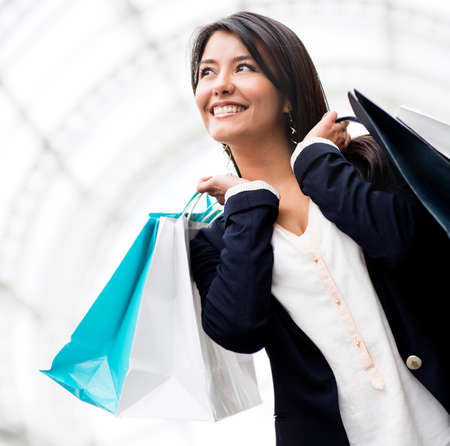 shoppingbag: Beautiful woman on a shopping spree holding bags