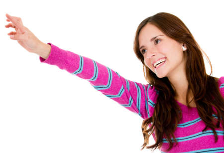 Casual woman pointing with her finger - isolated over a white background Stock Photo - 13977795