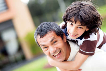 Father and son playing outdoors and having fun  photo