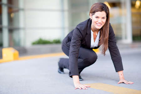 competitive business: Competitive business woman in a racing position  Stock Photo