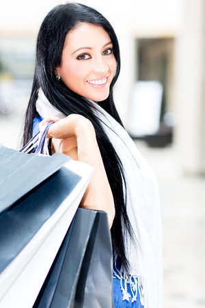 shopping spree: Beautiful shopping woman holding bags at the mall