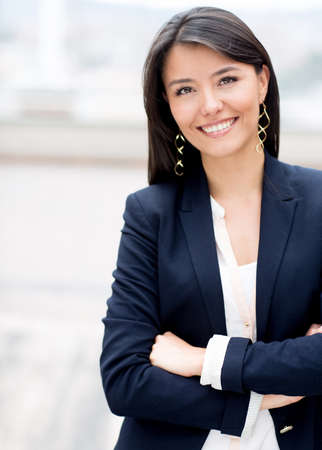 arms crossed: Casual business woman with arms crossed and smiling  Stock Photo