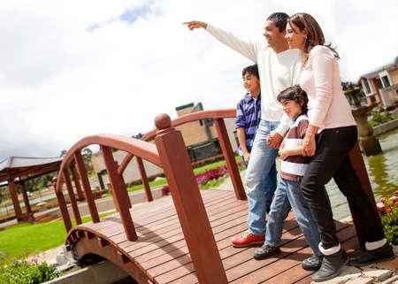 family latin: Beautiful family enjoying outdoors looking very happy