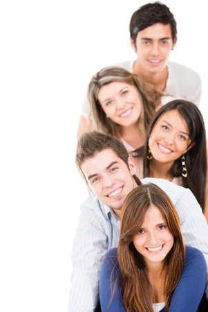 je�ne: Heureux groupe de jeunes dans une rang�e isol� sur blanc Banque d'images