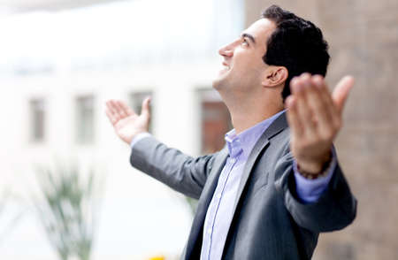 outstretched: Successful business man with arms open and smiling  Stock Photo