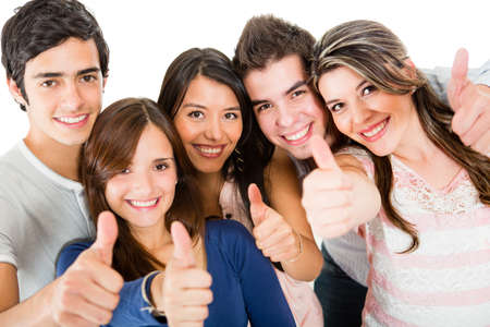 latin people: Group of friends with thumbs up - isolated over a white backgorund