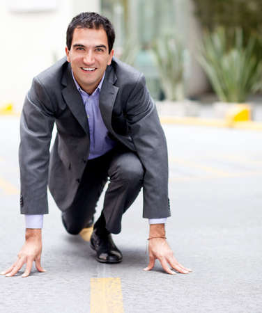 competitive business: Competitive business man in a racing position  Stock Photo