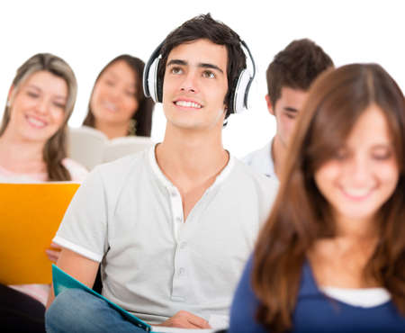 Student listening to music in class with headphones  photo