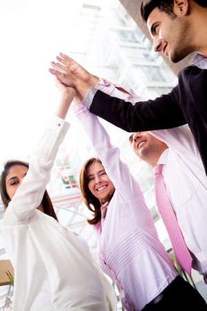 Successful business team celebrating with a high-five Stock Photo - 14024264