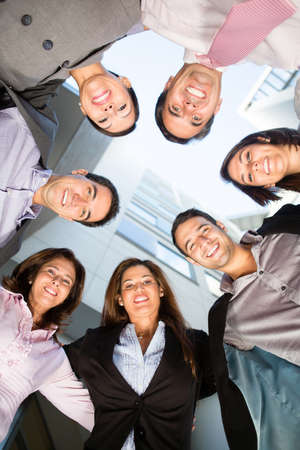 Group of business people in a circle smiling  Stock Photo - 14024345