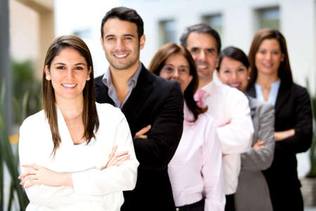 associate: Successful group of business people at the office