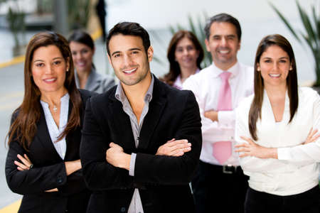 executives: Successful business group looking confident and smiling