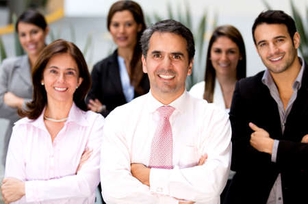 Successful business team at the office looking happy  Stock Photo - 14024256