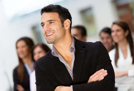 Thoughtful business man leading a corporate group photo