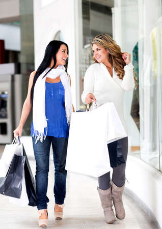 Friends walking at the shopping center looking happy  photo
