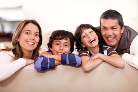 Happy family at home having fun and smiling  photo