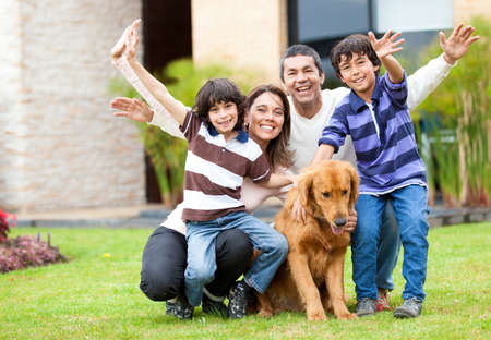 Happy family having fun outside their house  photo