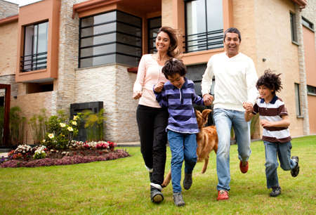 backyard woman: Happy family running together in the backgyard  Stock Photo