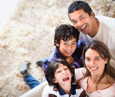 latin family: Portrait of a happy family smiling at home  Stock Photo