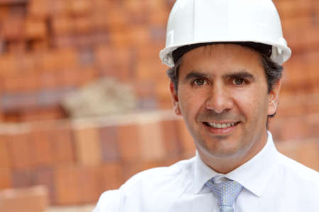 male engineer at a construction site smiling  photo