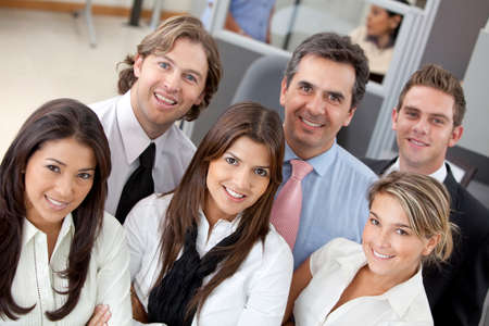 Entrepreneurs: Group of business people at the office smiling